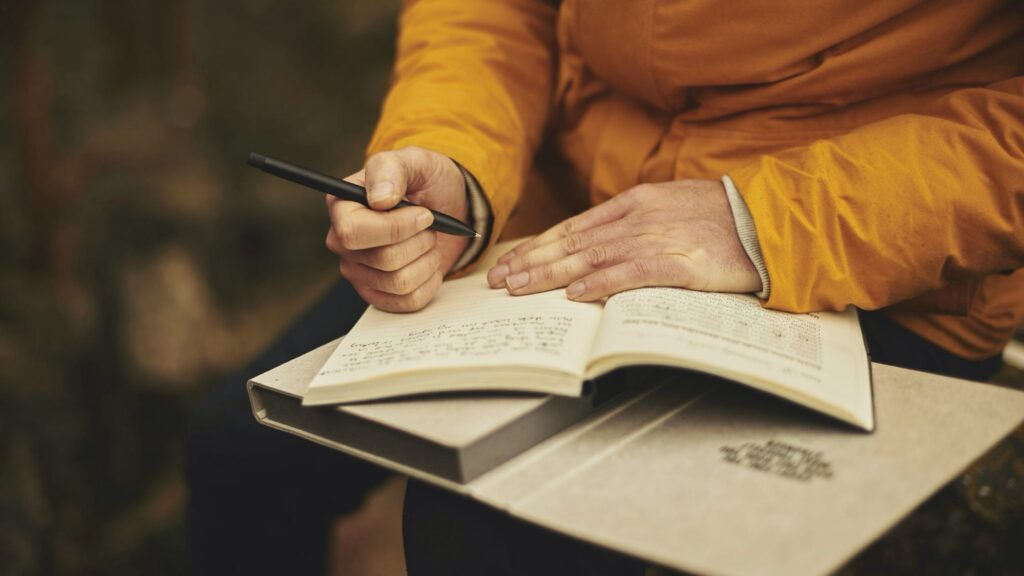 A person Journaling outdoors.