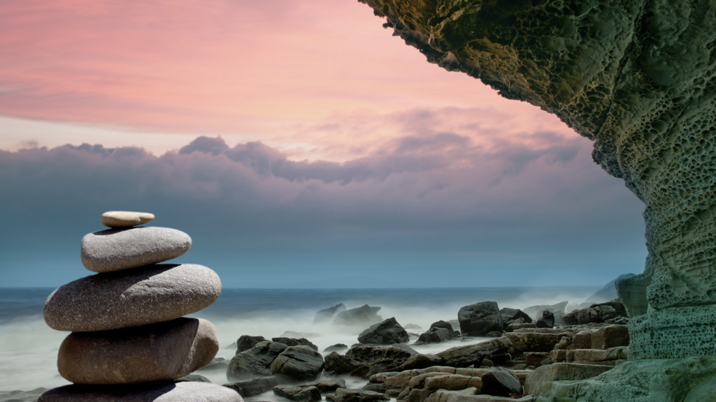 A pebble stack on a beautiful seaside background.