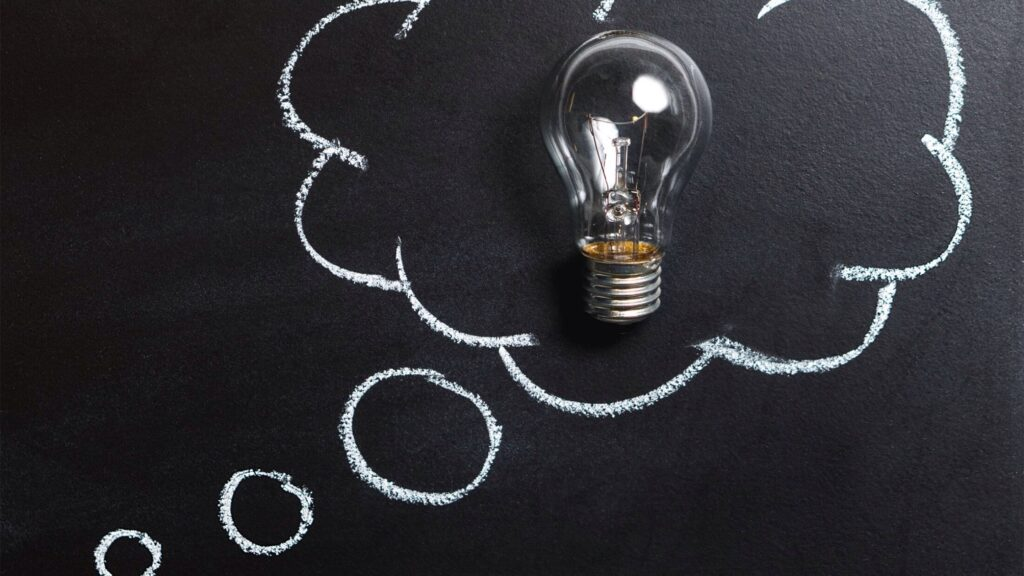 A lightbulb thought bubble on a blackboard.