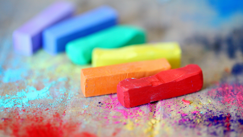 12 of 15 ways your phone can make you happy. Create with it. Art, video or music are all possible on your phone. Colourful artists chalk sits on a canvas drop sheet.