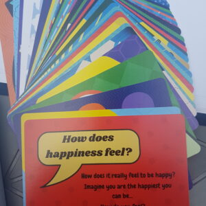 Demonstrated the bright colours of the write for happiness card deck, Fanned out they look like a rainbow